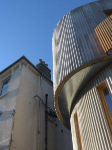 Corrugated curvy concrete exterior walls image2
