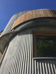 Corrugated curvy concrete exterior walls